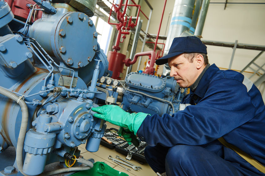 Technician Working on Air Compressor - Compressed Air System Maintenance | AIRPLUS Industrial