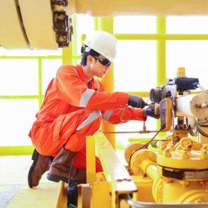 Technician Rebuilding Equipment On Site | AIRPLUS Industrial