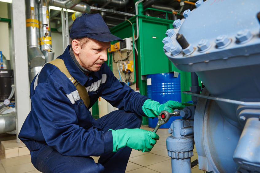 Service Technician Working on Compressor System | AIRPLUS Industrial